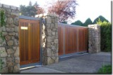 Sliding gate with teak inserts with matching Pedestrian Gate.
